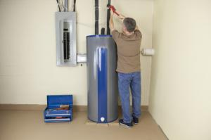 an Union City water heater repair tech is repairing a water heater
